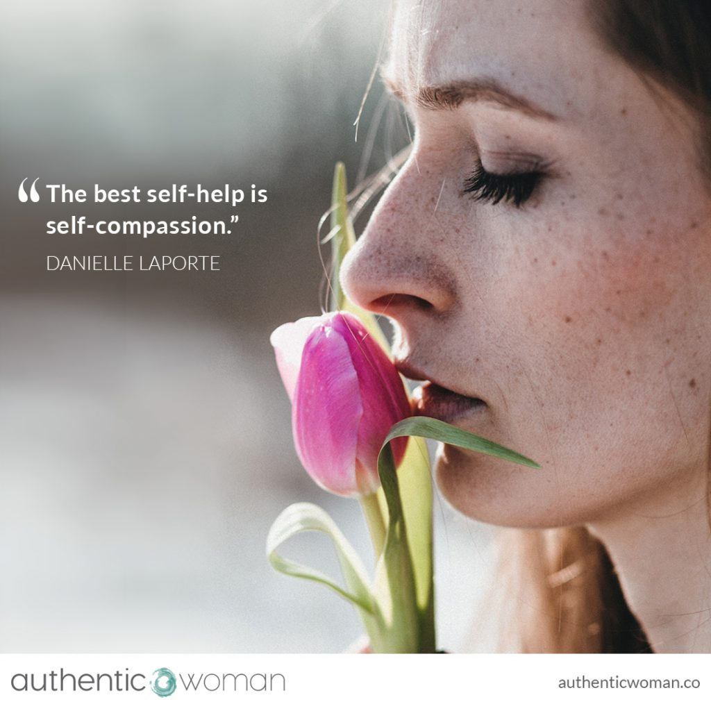 Woman with closed eyes offering herself self compassion
