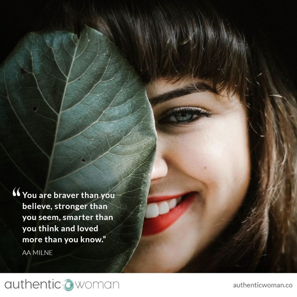 Athentic Confident woman looking from behind leaf