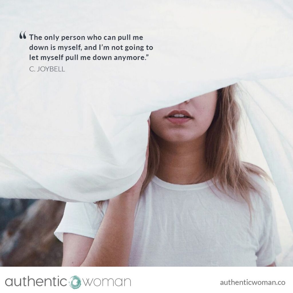 Authentic woman with white sheet of self-acceptance