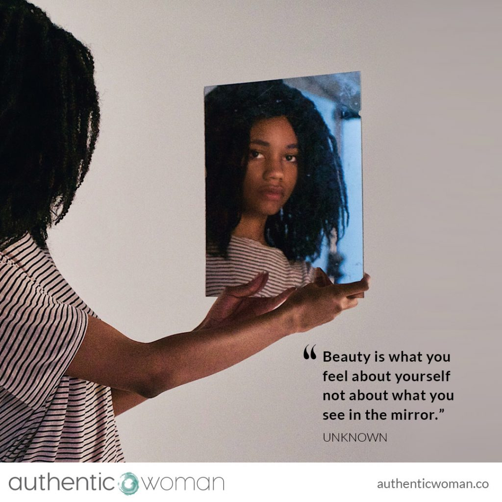 authentic woman looking in mirror